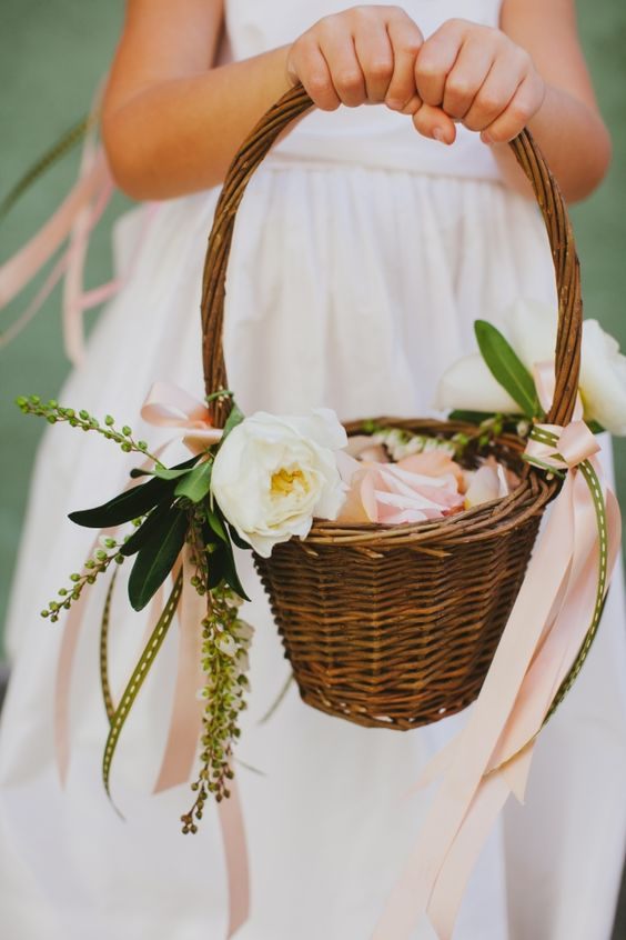 cute flower girl basket with petals and ribbon