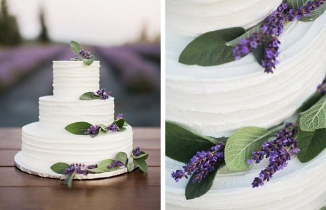 The simple frosted wedding cake is decorated with lavender