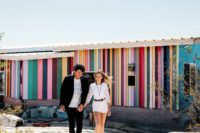 03 They got ready in a rainbow desert rental decorated in boho chic style