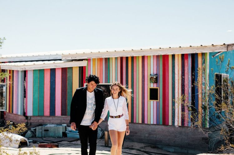 They got ready in a rainbow desert rental decorated in boho chic style