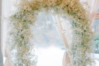 03 baby's breath wedding arch with hanging candle holders will make your ceremony heavenly and elegant