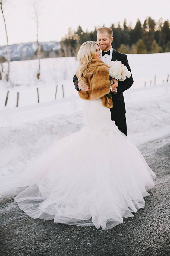 chic fur cover up adds glam to this bridal outfit