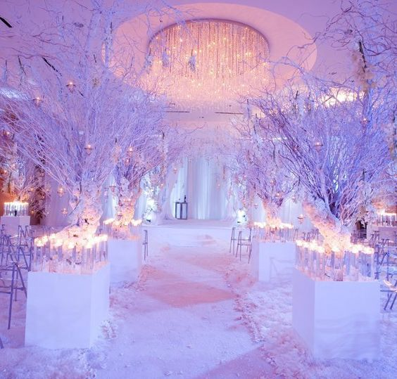 faux snow, candles, white petals and crystals for wedding decor