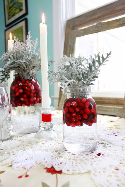 mason jars filled with water, dumped fresh cranberries and Dusty Miller