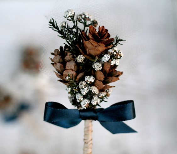 pinecone boutonniere with a bow
