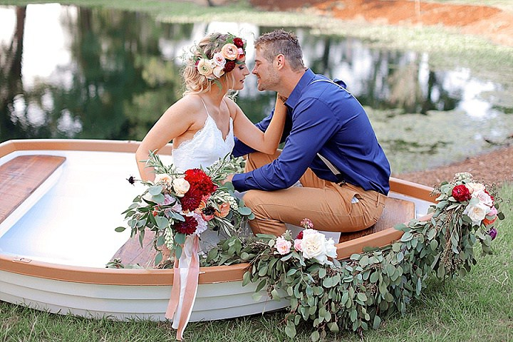 Canoe decorated with flowers is a nice idea for those who have lakes or rivers near the venue