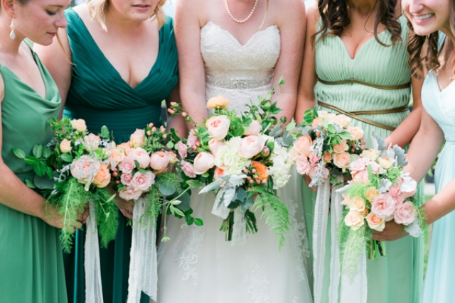 The bridesmaids chose dresses in shades of green to create an ombre effect