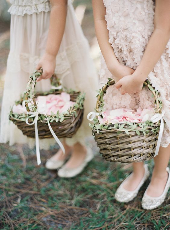 greenery accented woven flower girl baskets