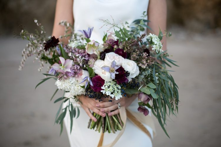 The bouquet was done in the shades of purple and blush, it's boho and relaxed