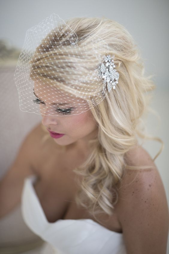 birdcage veil with a rhinestone comb and long hair down