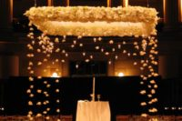 05 gorgeous wedding chuppah decorated with white blooms and candles