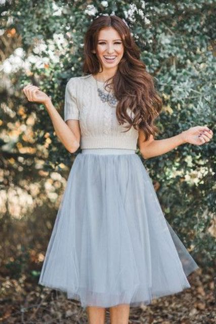 grey tulle skirt, a grey sweater and a statement necklace