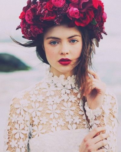 oversized red and pink flower crown and fuchsia lips