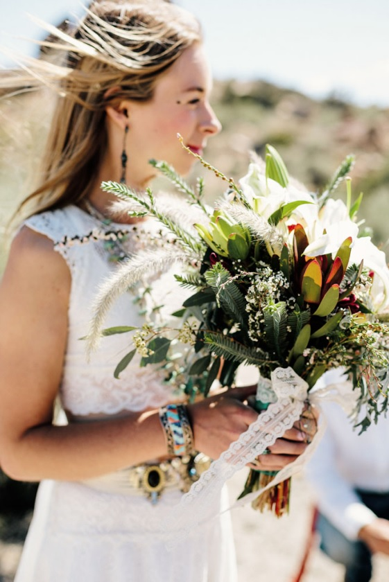 The bouquet was boho chic, with greenery, leaves and feathers