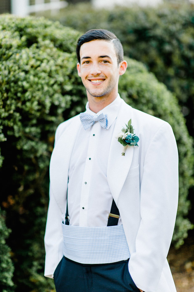 The groom was wearing a serenity blue belt, bow tie and boutonniere, wwhich looked amazingly refreshing