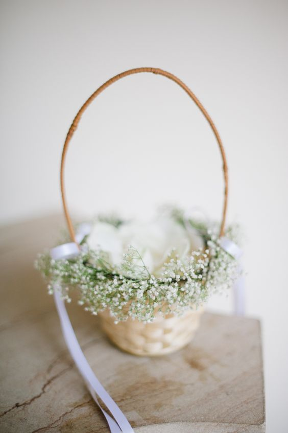 flower girl basket decorated with baby's breath