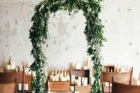 06 green leaves and some small white flowers on top is a cool idea for every indoor ceremony