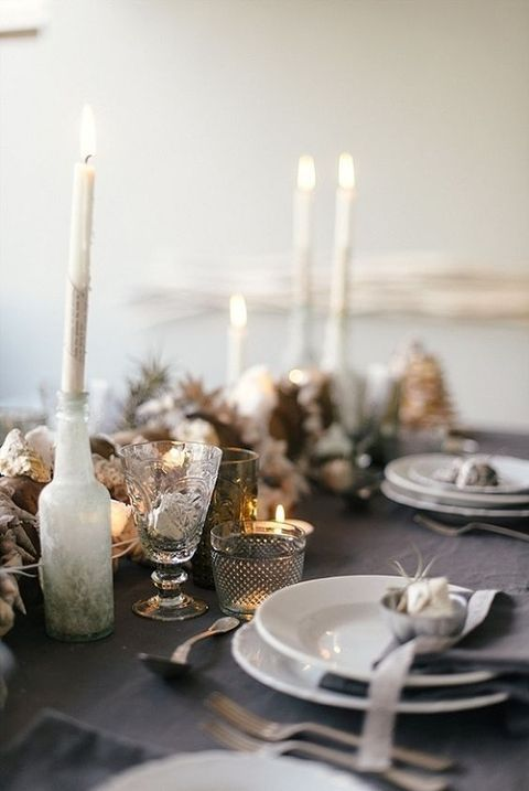 grey and brown winter table setting with candles