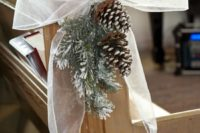 06 pinecone and snowy fir branches with a bow for aisle decor