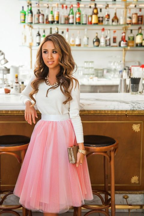 pink tutu skirt, a white sweater and a necklace