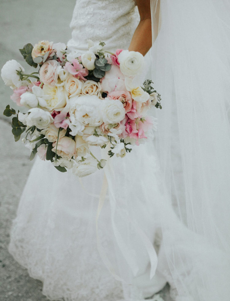 Lush, pastel bridal bouquet filled with peonies and ranunculus