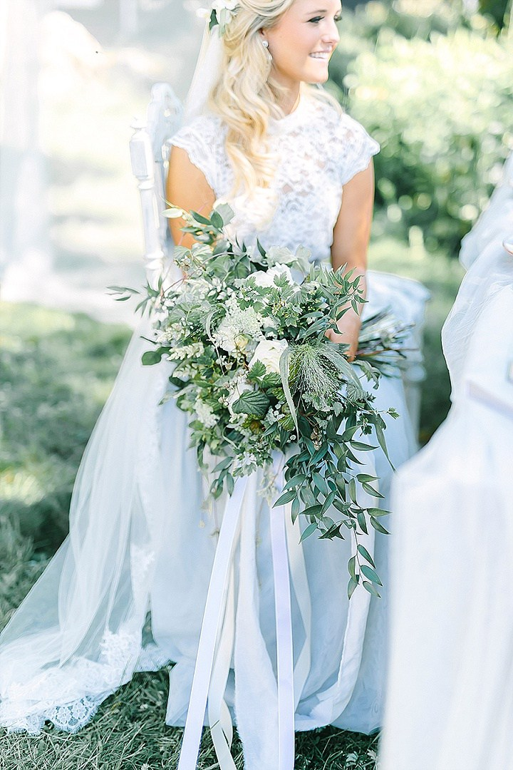 The bride was rocking a trendy separate with a white lace top and a pale blue maxi skirt