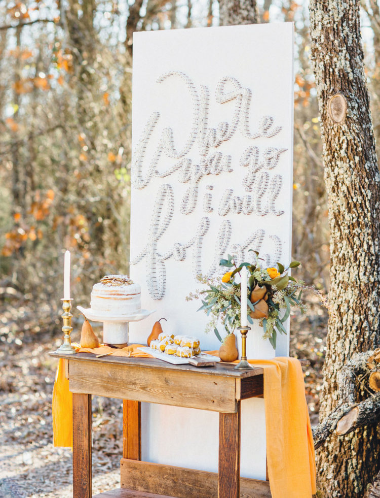 The dessert table is a cozy rustic one, with warm sunny yellow touches