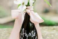 07 Wine bottles as favors decorated with dusty pink ribbon