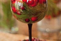 07 glass with a floating candle, fir branches and cranberries