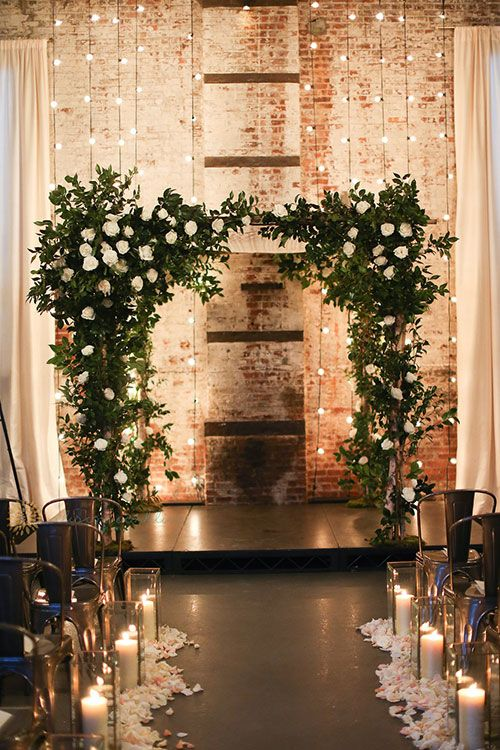 greenery and white roses are an elegant idea for a winter ceremony