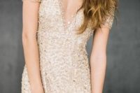 07 plunging neckline with large beads all over is perfect for snowy or New Year weddings
