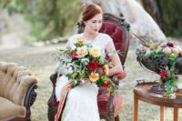 07 the bride has a lush bouquet in fall tones with bold ribbons