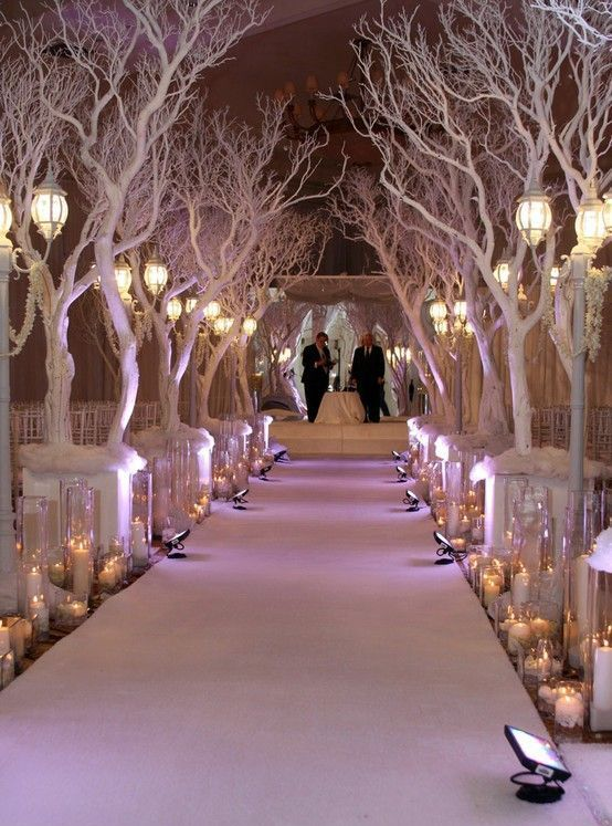 wedding aisle lined with trees, faux snow and candles