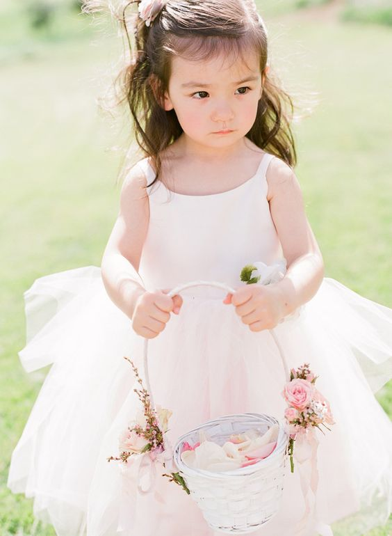 white flower girl basket with blush flowers