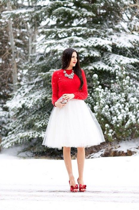 white tutu, a red sweater, heels and a statement necklace