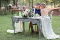 08 A chalk vintage table was used as a sweetheart one, it was decorated with lush flowers