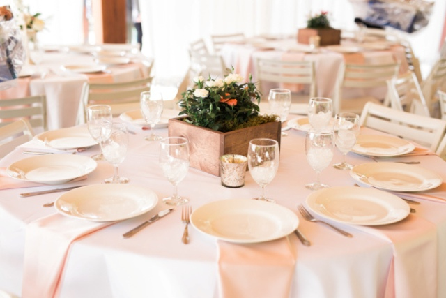 Tables were decorated in a delicate yet simple manner, with blush touches