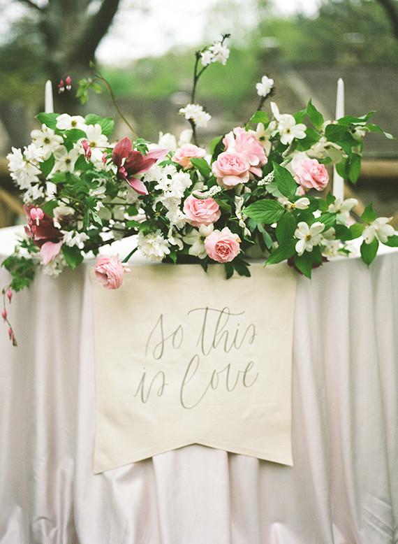 This lush floral centerpiece was done in pink, blush and cream and perfectly highlighted the shoot decor