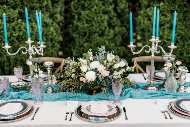 Turquoise table runner and candles refreshed the tablescape and made it bolder