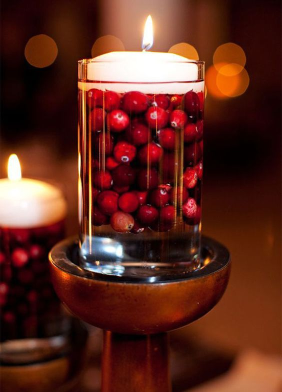 glass with cranberries and a floating candle is a simple centerpiece