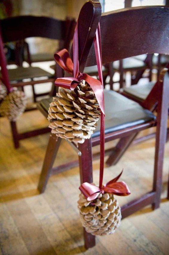 large pinecones on ribbon for wedding aisle decor