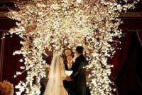 08 lush white floral wedding arch is perfect for winter wonderland weddings