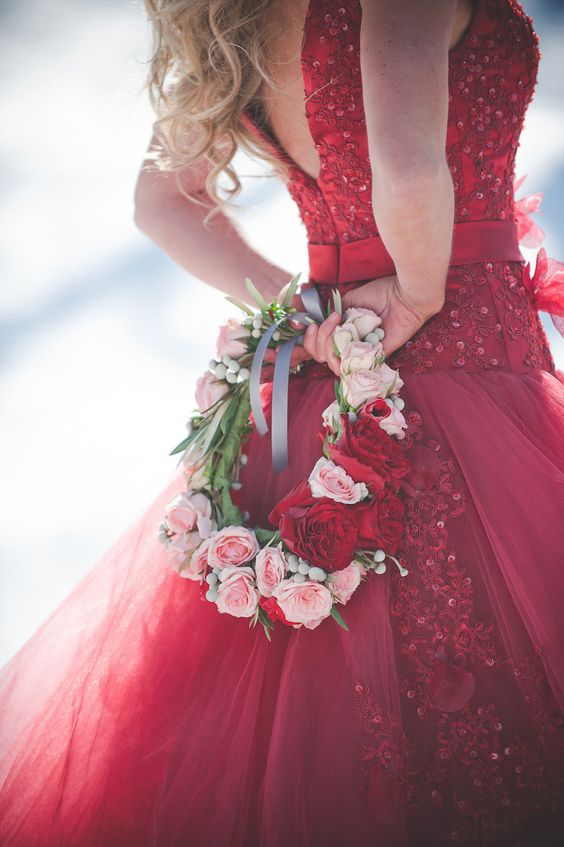 red and blush rose flower crown to rock with a hot red wedding dress