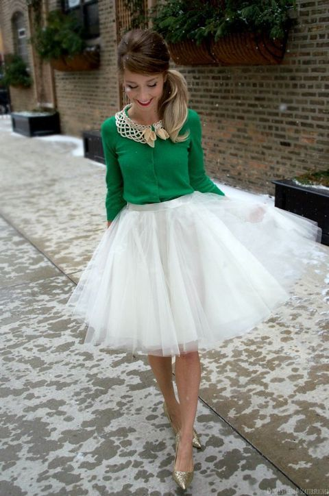 white tutu skirt, a green sweater and glitter shoes