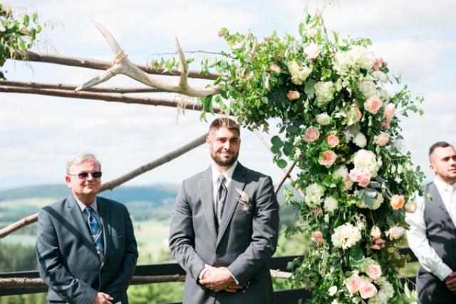 Lush florals for decorating a wedding arch is a great idea for spring, and antlers add a rustic feel