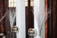 09 modern indoor arch with white flowers and metal spheres