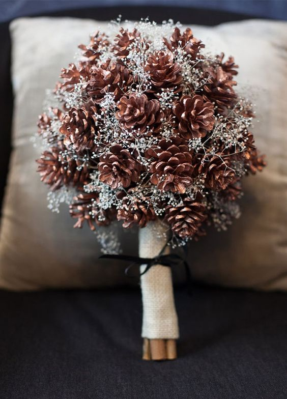 pinecone wedding bouquet is perfect for rustic and woodland winter nuptials
