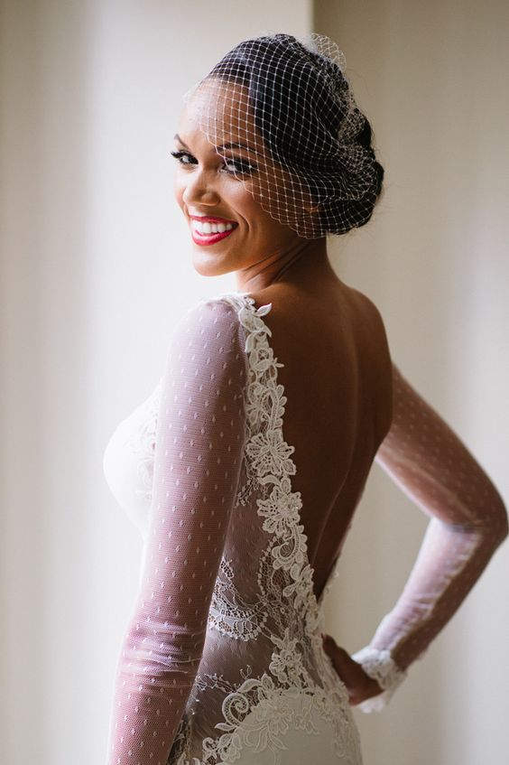 stylish updo with a classic birdcage veil