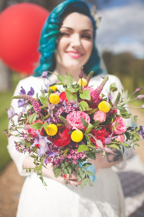 The bridal bouquet was also super bold, with billy balls