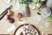 10 Wooden chargers, plaid napkins, a fabric table runner and fruit make it comfier